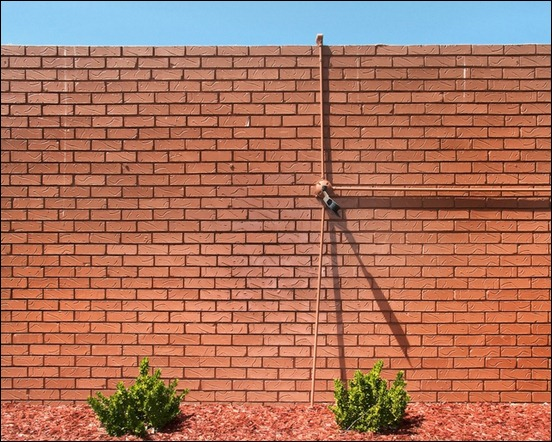 listens-like-a-brick-wall-