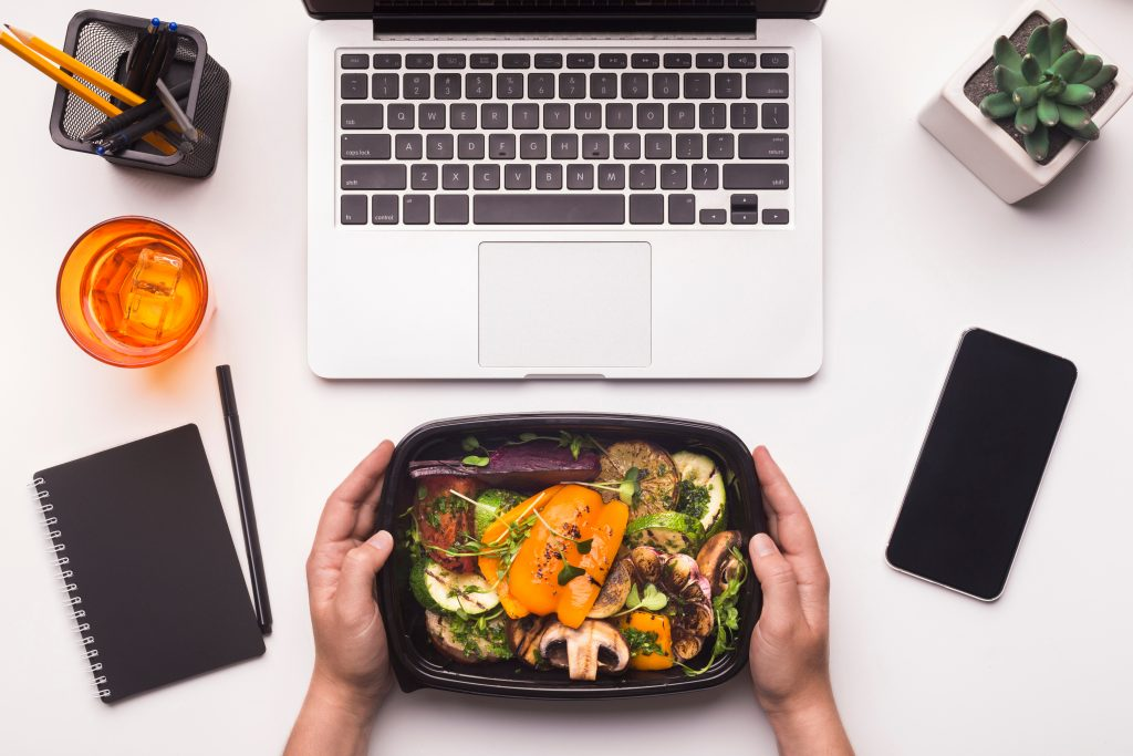 Takeaway food, computer and a smartphone.