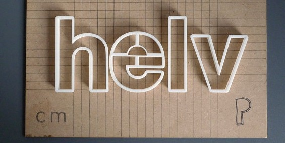 "3D Printed text that reads ""helv."""