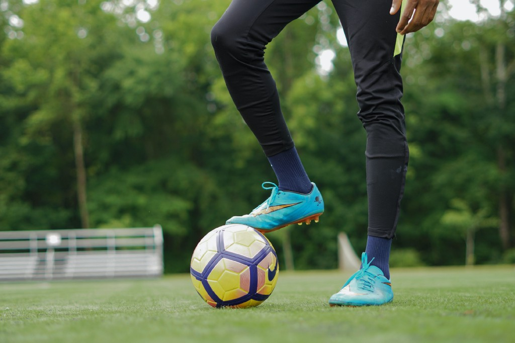 Soccer player about to kick off game