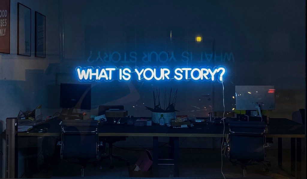 Widnow with 'What is your story?' in lights