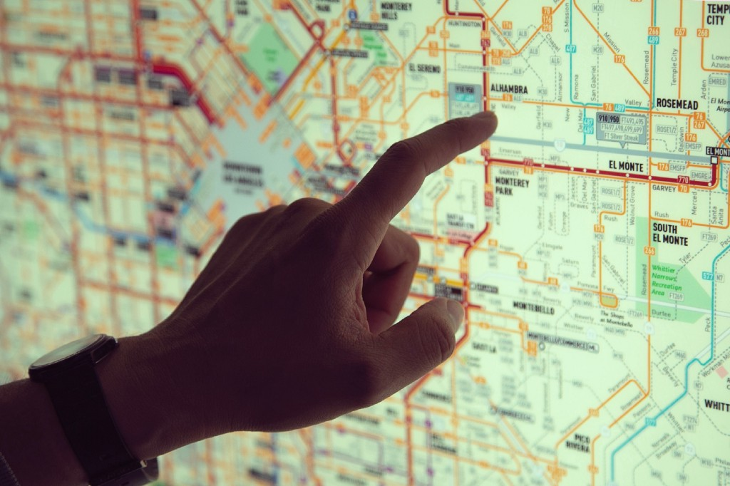 Person pointing on digital street map