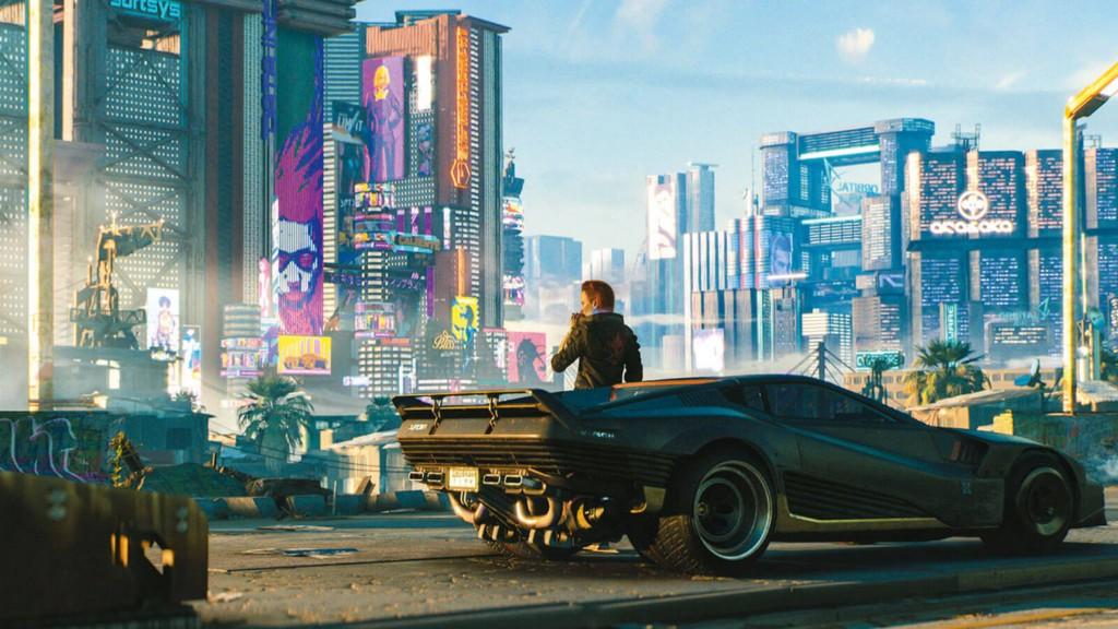 "A cityscape screenshot from the videogame ""Cyberpunk 2077""."