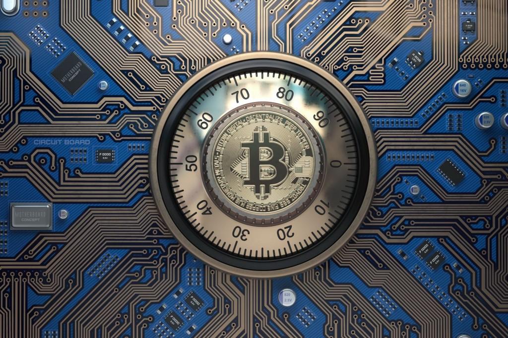 Bitcoin logo embedded onto a safe lock.